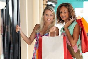Shopping Tour Germany - Two ladies are happy that they shopped with myGermany using our Package Forwarding Service